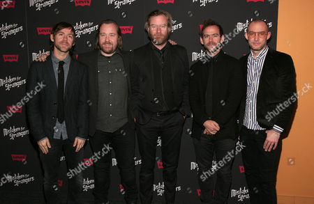 """Stock Image of Director Tom Berninger, second from left, poses with members of the band The National, from left, Aaron Dessner, Matt Berninger, Bryce Dessner and Scott Devendorf, at a screening of """"Mistaken For Strangers"""" on in New York"""