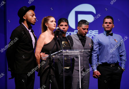 Barbara Poma, center, and survivors speak at onePULSE: A Benefit for Orlando at NeueHouse Hollywood, in Los Angeles