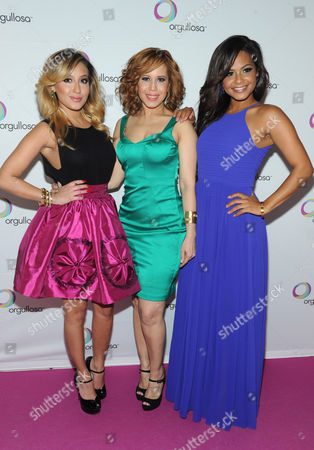 """Adrienne Bailon, left, designer Cenia Paredes, center, Christina Milian help Procter & Gamble's Orgullosa community unveil its """"Skirts Only"""" fashion show, in New York, featuring exclusive designs from CENIA. Orgullosa was created to celebrate, empower and fuel Latinas' accomplishments. Visit Facebook.com/Orgullosa for more information"""