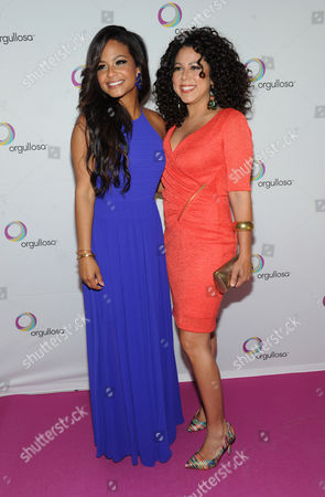"""Christina Milian, left, and Evette Rios, of ABC's """"The Chew,"""" help Procter & Gamble's Orgullosa community unveil its """"Skirts Only"""" fashion show, in New York, featuring exclusive designs from CENIA. Orgullosa was created to celebrate, empower and fuel Latinas' accomplishments. Visit Facebook.com/Orgullosa for more information"""
