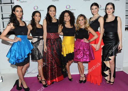 """Adrienne Bailon, third from right, and Evette Rios, center, of ABC's """"The Chew,"""" joined by models wearing designs by Latina designer CENIA, help Procter & Gamble's Orgullosa community unveil its """"Skirts Only"""" fashion show, in New York. Orgullosa was created to celebrate, empower and fuel Latinas' accomplishments. Visit Facebook.com/Orgullosa for more information"""
