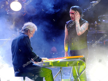 Marily Manson, right, is joined by Ray Manzarek of The Doors during his headlining performance at the Sunset Strip Music Festival, in West Hollywood, Calif