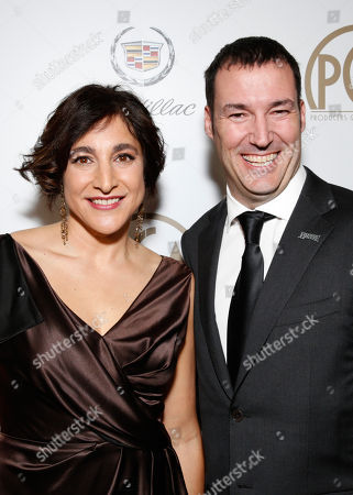 Katherine Sarafian and Mark Andrews are seen backstage during the cocktail reception at the 24th Annual Producers Guild (PGA) Awards at the Beverly Hilton Hotel, in Beverly Hills, Calif