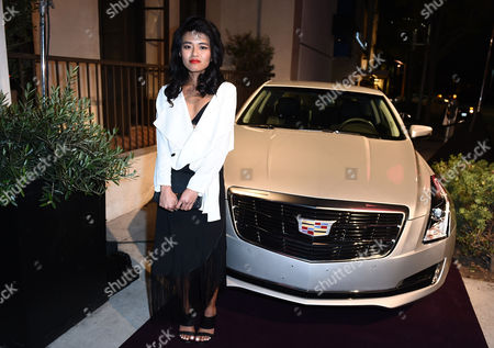 Olivia Lopez poses with the 2015 Cadillac ATS Coupe at The Hollywood Reporter Nominees Night presented by Cadillac, with Delta, Roberto Coin, and Neiman Marcus Beverly Hills at Spago on Mon., in Beverly Hills, Calif