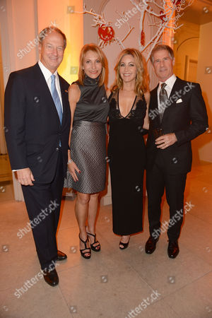 In this photo provided by Lionsgate, U.S. Ambassador to Germany John B. Emerson, Kimberly M. Emerson, Laurie Feltheimer, and Lionsgate CEO Jon Feltheimer at a private dinner celebrating the release of THE HUNGER GAMES: MOCKINGJAY - PART 2 in Berlin