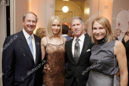In this photo provided by Lionsgate, U.S. Ambassador to Germany John B. Emerson, Jennifer Lawrence, Lionsgate CEO Jon Feltheimer, and Kimberly M. Emerson at a private dinner celebrating the release of THE HUNGER GAMES: MOCKINGJAY - PART 2 in Berlin