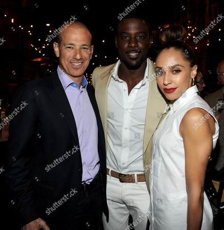 L-R) Executive producer Howard Gordon, Lance Gross, and Rebecca Jefferson attend the Twentieth Century Fox Television Distribution's 2013 LA Screenings Lot Party on in Los Angeles, California