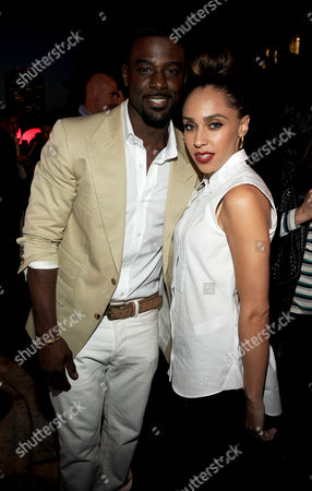 Lance Gross, left, and Rebecca Jefferson attend the Twentieth Century Fox Television Distribution's 2013 LA Screenings Lot Party on in Los Angeles, California