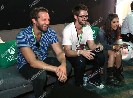 Stock Image of From left, Ryan Hansen, Rob Buckley and Janina Gavankar interact with newly announced games and experiences at the Xbox booth at E3 in Los Angeles on