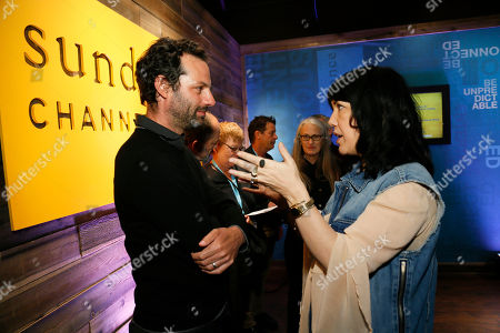 """Executive Vice President & General Manager of Sundance Channel Sarah Barnett, right, talks with """"Top of the Lake"""" producer Emile Sherman, left, at Sundance Channel's Annual Festival Celebration during the 2013 Sundance Film Festival on in Park City, Utah"""