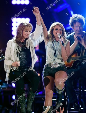 "Stock Image of Patty Loveless, left, and Miranda Lambert perform together at ""ACM Presents: Superstar Duets"" at Globe Life Park, in Arlington, Texas"