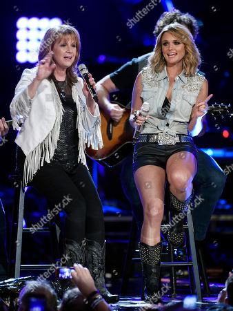 "Stock Picture of Patty Loveless, left, and Miranda Lambert perform together at ""ACM Presents: Superstar Duets"" at Globe Life Park, in Arlington, Texas"