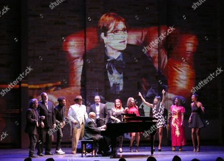 Ellis Hall performs at Backstage at the Geffen, in Los Angeles. Carrie Fisher is seen onscreen