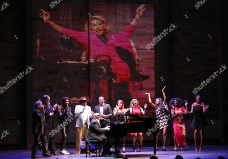 Stock Picture of Ellis Hall performs at Backstage at the Geffen, in Los Angeles. Joan Rivers is seen onscreen