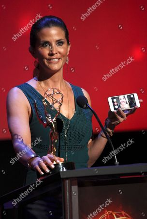 Lu Parker from KTLA5/KTLA5 News At Ten accepts the Emmy for Light News Story (Single Report) for Homeless Headshots at the L.A. Area Emmy Awards presented at the Television Academy's new Saban Media Center, in the NoHo Arts District in Los Angeles