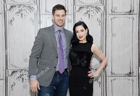 """Burlesque performer and model Dita Von Teese poses with moderator Tim Morehouse during AOL's BUILD Speaker Series to discuss her new book, """"Your Beauty Mark: The Ultimate Guide to Eccentric Glamour"""", at AOL Studios, in New York"""