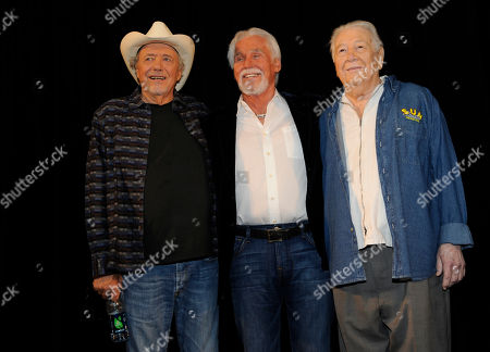 Stock Image of Bobby Bare, left, Kenny Rogers, and Cowboy Jack Clement, right, attend the Country Music Hall of Fame Nominees Announcements at the Hall of Fame Rotunda on in Nashville Tenn