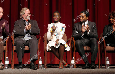 Cinematographer Sean Bobbitt, Lupita Nyong'o and Chiwetel Ejiofor attend Fox Searchlight's Los Angeles Premiere of 12 Years A Slave, on Monday, October, 4th, 2013 in Los Angeles