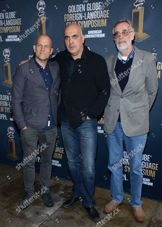 Stock Image of Producer Ivo Felt, director Zaza Urushadze, and actor Lembit Ulfsak arrive at Golden Globes Foreign Language Symposium at Egyptian Theatre, in Los Angeles, Calif