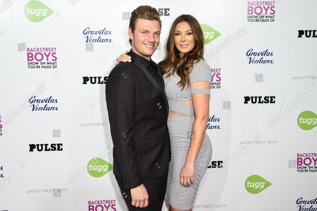 Nick Carter, left, and Lauren Kitt arrive at the Backstreet Boys: Show â?˜Em What You're Made Of premiere at the Arclight Cinemas - Cinerama Dome, in Los Angeles