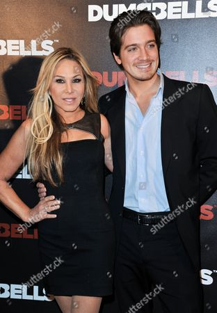 Adrienne Maloof, left, and Jacob Busch arrives at the LA Premiere of 'Dumbbells' at Supperclub on in Los Angeles