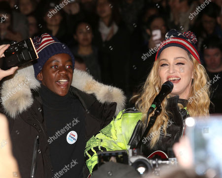 Madonna, right, and her son David Banda perform in support of the Hillary Clinton campaign at Washington Square Park, in New York