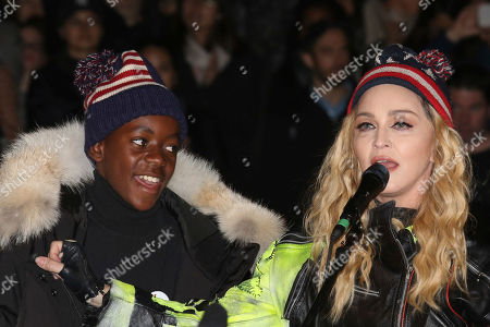 Singer Madonna, right, and her son David Banda perform in support of Democratical presidential candidate Hillary Clinton at Washington Square Park, in New York