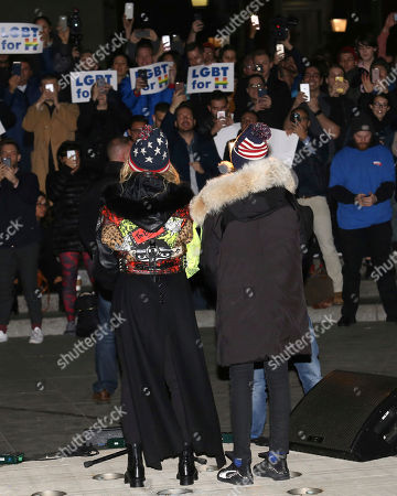 Madonna, left, and her son David Banda perform in support of the Hillary Clinton campaign at Washington Square Park, in New York