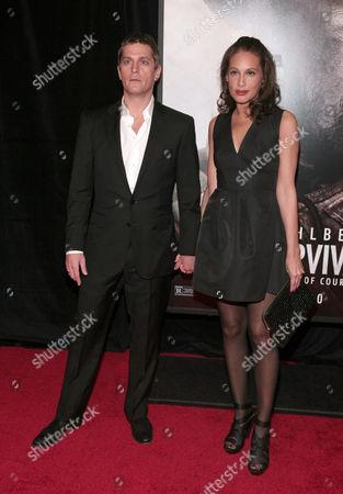 """Recording artist Rob Thomas, left, and his wife, fashion model Marisol Maldonado, right, attend the New York premiere of """"Lone Survivor"""", in New York"""