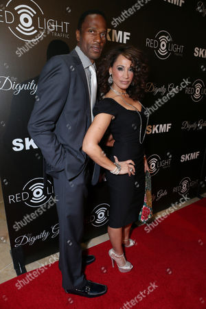 Willie Gault and Suzan Brittan seen at The Inaugural Dignity Gala, on Friday, Oct., 18, 2013 in Los Angeles