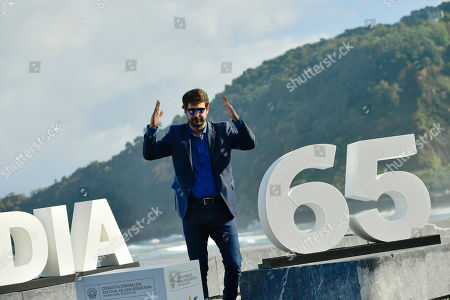 Argentinian film director, Santiago Mitre, poses during the photo call to promotes his film, ''La Cordillera'' (The Mountain Range'), at the 65th San Sebastian Film Festival, in San Sebastian, northern Spain, . The festival is one of the most prestigious and internationally recognised in Spain and Latin America