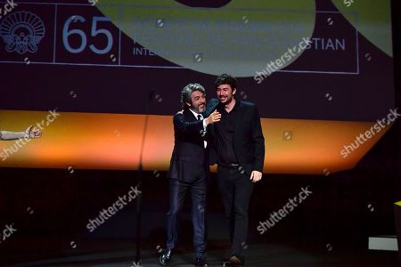 Ricardo Darin, Santiago Mitre. Argentinian actor and winner of the Donostia Award, Ricardo Darin, left, is congratulated by Argentinian film director, Santiago Mitre, after receiving the award for his contribution to the cinema, at the 65th San Sebastian Film Festival, in San Sebastian, northern Spain, . The festival is one of the most prestigious and internationally recognised