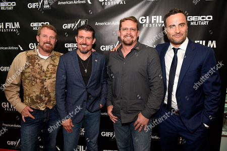 "IMAGE DISTRIBUTED FOR PARAMOUNT PICTURES - Benghazi Annex Security Team members from left to right-Mark ""Oz"" Geist, Kris ""Tanto"" Paronto, John ""Tig"" Tiegen and actor Dominic Fumusa arrive for a special screening of 13 Hours: The Secret Soldiers of Benghazi at the closing ceremony of the G.I. Film Festival on in Washington, DC. The film is now available on Digital HD and arrives on Blu-ray June 7 on Sunday, May 29th, 2016, in Fairfax, Va"