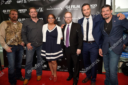 """Members of the Benghazi Annex Security team, actor Dominic Fumusa who played """"Tig"""", and the co-founders of the GI Film Festival celebrate13 Hours: The Secret Soldiers of Benghazi at the closing ceremony of the G.I. Film Festival on in Washington, DC. From left to right, Mark """"Oz"""" Geist, John """"Tig"""" Tiegen, Laura Law-Millet, Brandon Millet, actor Dominic Fumusa and Kris """"Tanto"""" Paronto,The film is now available on Digital HD and arrives on Blu-ray June 7 on Sunday, May 29th, 2016, in Fairfax, Va"""