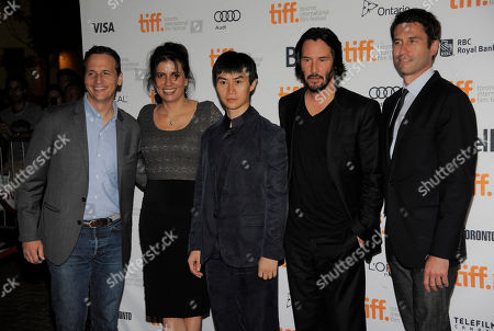 """Stock Image of Keanu Reeves, second from right, director and cast member in """"Man of Tai Chi,"""" poses with, left to right, Radius-TWC co-president Tom Quinn, producer Lemore Syvan, cast member Tiger Hu Chen and Radius-TWC co-president Jason Janego at the premiere of the film on day 6 of the 2013 Toronto International Film Festival at the Ryerson Theatre on in Toronto"""