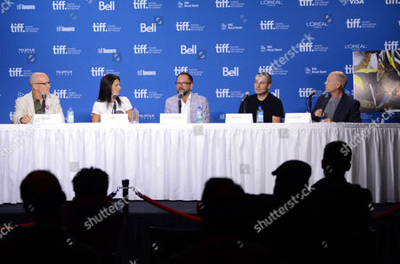 """Alex Gibney, from left, Betsy Andreu, Jonathan Vaughters, Bill Strickland and Frank Marshall attend the press conference for """"The Armstrong Lie"""" on day 5 of the Toronto International Film Festival at the TIFF Bell Lightbox, in Toronto"""