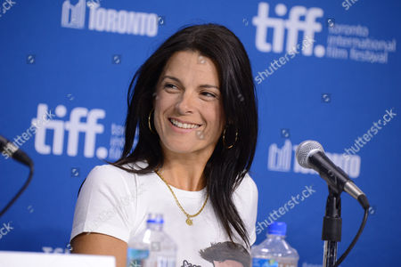 """Betsy Andreu smiles at the press conference for """"The Armstrong Lie"""" on day 5 of the Toronto International Film Festival at the TIFF Bell Lightbox, in Toronto"""