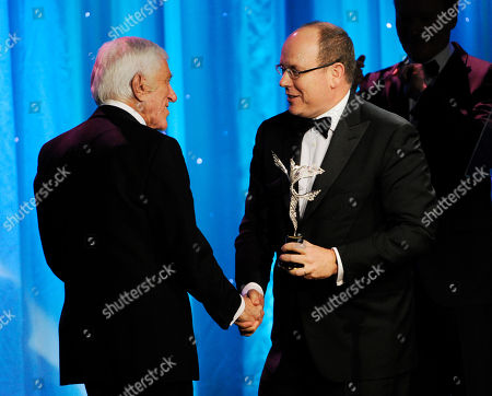 Actor Dick Van Dyke, left, accepts the Prince Rainier III Award from Prince Albert II of Monaco during the 2014 Princess Grace Awards Gala at the Beverly Wilshire Hotel, in Beverly Hills, Calif