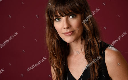 "Devin Kelley, a cast member in The CW series ""Frequency,"" poses for a portrait during the 2016 Television Critics Association Summer Press Tour at the Beverly Hilton, in Beverly Hills, Calif"