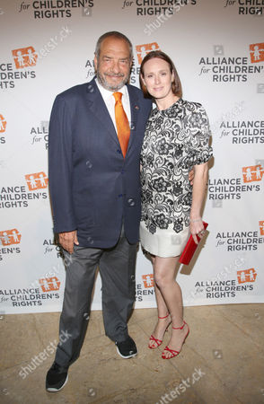 Dick Wolf, left, and Noelle Lippman arrive at the 22nd Annual Alliance for Children's Rights Dinner at The Beverly Hilton Hotel on in Beverly Hills, Calif