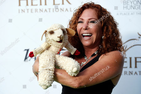 """Mallory Lewis poses with """"Lambchop"""" at the 4th Annual Beyond Hunger: """"A Place at the Table"""" gala at the Montage Hotel, in Beverly Hills, Calif"""