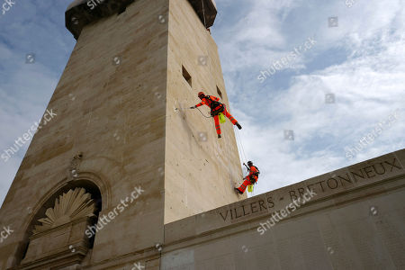 Workers are seen at the Australian National Memorial during the visit of Australian Governor Sir Peter Cosgrove at the Sir John Monash memorial Centre that will honour Australian soldiers involved in WWI, in Villers-Bretonneux, northern France