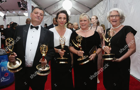 Steven Moffat, from left, Amanda Abbington, Sue Vertue, and Rebecca Eaton winners of the award for outstanding television movie for Sherlock: The Abominable Bride (Masterpiece) attend the 68th Primetime Emmy Awards, at the Microsoft Theater in Los Angeles