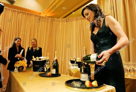 Stock Image of Aida Mollenkamp of Moet & Chandon pours out champagne at the 71st Annual Golden Globes Menu Preview,, at The Beverly Hilton in Beverly Hills, Calif. The 71st Annual Golden Globe Awards will be held at The Beverly Hilton on Sunday, January 12