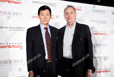 Peng Chen, China Beijing Film Delegation, and Jonathan Wolf, Executive Vice President & Managing Director of the American Film Market, arrives at American Film Market China Reception at the Loews Santa Monica Beach Hotel on Wendeday, in Santa Monica, Calif