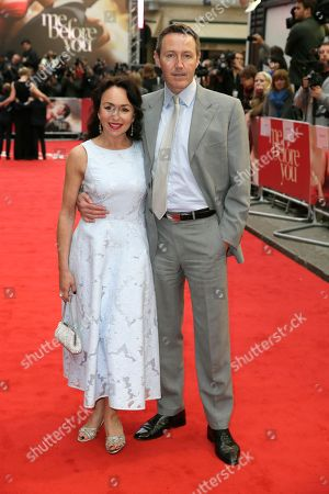 Actors Samantha Spiro and Mark Leadbetter pose for photographers upon arrival at the premiere of the film 'Me Before You' in London