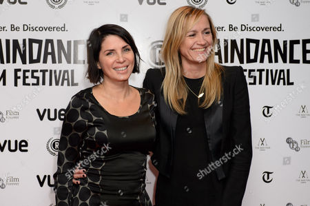 British actress Sadie Frost, left and Producer Emma Comley arrive for the Raindance Film festival Opening Gala of I Origins at a central London cinema, London