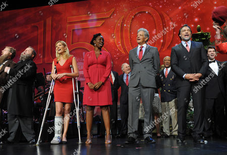 Cornell alumni Kate Snow, left, Adepero Oduye, second left, Ed Marinaro, second right, and Jimmy Smits, right, sing their alma mater at an event celebrating Cornell University's 150th anniversary year, at Jazz at Lincoln Center in New York