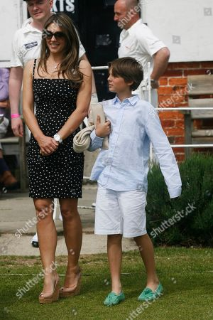 """Stock Image of Elizabeth Hurley attends with her son Damien the """"Cricket for Kids"""" charity match she is hosting between England and Australia at the Cirencester Tennis Club in Cirencester in England on"""