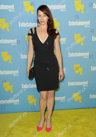 Melinda Clarke arrives at the Entertainment Weekly annual Comic-Con celebration on in San Diego, California